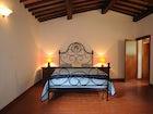 Bedroom at Barbicaio Saturnana Agriturismo
