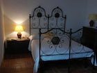 Typical tuscan decor with wrought iron bedstands