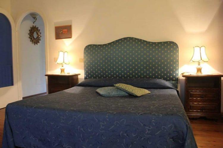 Camera arredata in stile classico-tradizionale