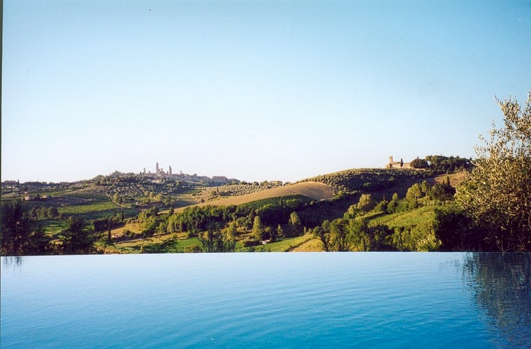 The pool has an incredible view over San Gimignano