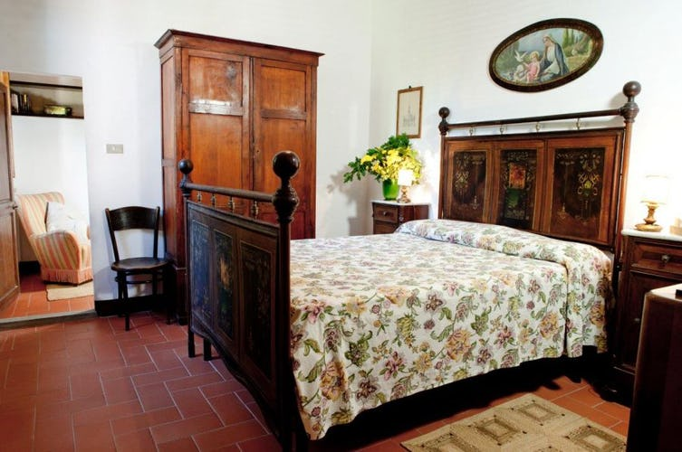 Family antiques are used in the villa decor at Tenuta Bossi