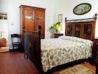 Family antiques are used in the villa decor at Tenuta Bossi
