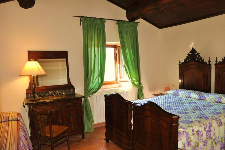 One of the bedroom with typical Tuscan furnishing
