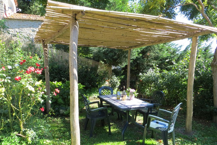 A private gazebo with table and chairs
