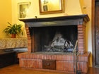 Inviting fireplace with space for friends and family to visit