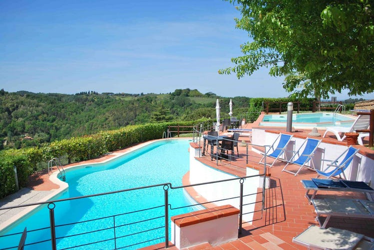 The area around the pool has sun loungers and umbrellas to relax under the Tuscan sun