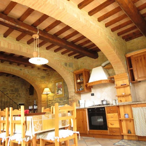 Brick arches and wooden beams accent the original architecture