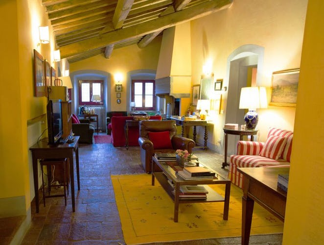 Classical Tuscan architecture with large fireplace & terracotta floors