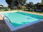 Enjoy time pool side with the table & chairs  provided