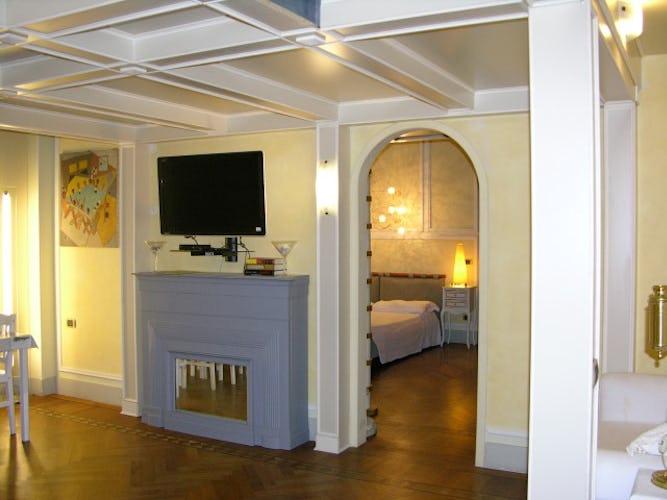 David Apartment - Ampio soggiorno con TV