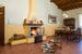 Warm and inviting with a cozy fireplace and wood beam cielings