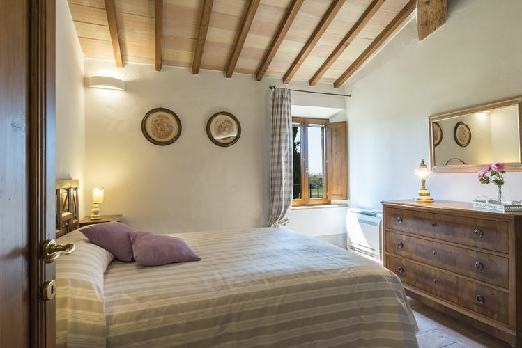 I Cipressini Villa Rental double bedroom with a view