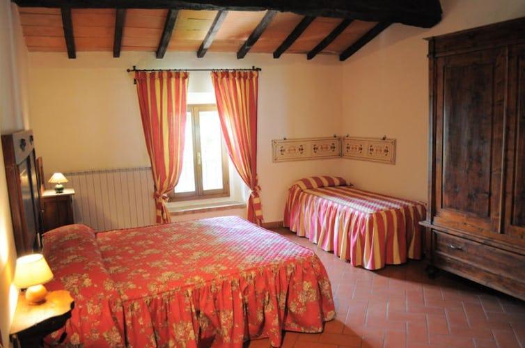 Camera da letto appartamento Poiana
