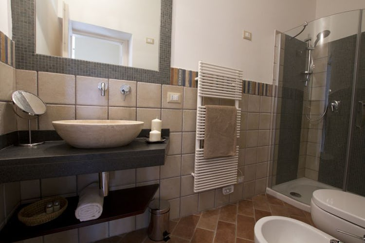 Bathrooms are all modernly and stylishly furnished