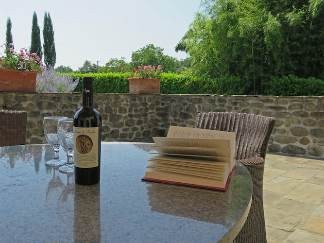 La Loggia Fiorita holiday villa rental and a furnished courtyard
