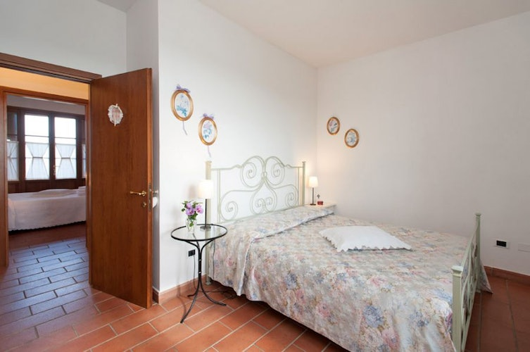 Spacious bedrooms in the rental apartments at La Masseria