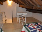 The holiday apartment was restored to maintain the wood beam ceilings