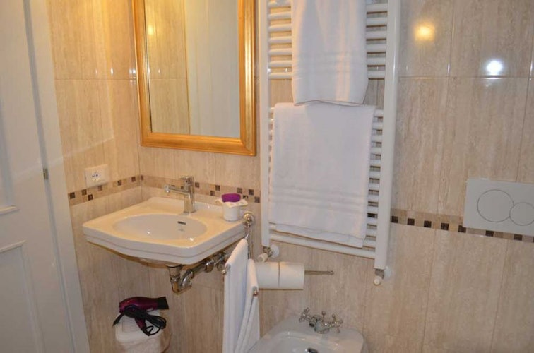 The bathrooms are supplied with towel warmers and hairdryers
