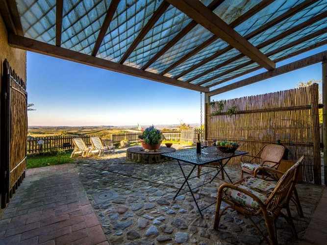 Panoramic views of the San Gimignano landscape at Macinella Apartments
