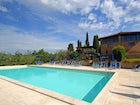 A large panoramic pool for the guests at B&B Palagetto di Sotto