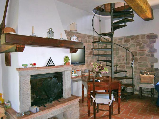 The fireplace and living room