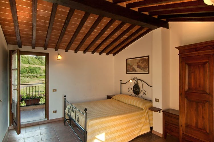 Traditional Tuscan decor with wrought iron bedstands