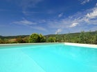 Enjoy the Dan Gimignano countryside at the pool at Torre Palagetto
