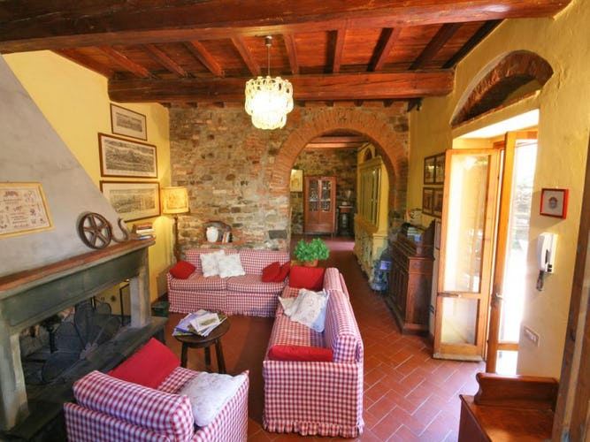 Wooden beamed ceilings, stone fireplaces & walls at Villa Cafaggiolo