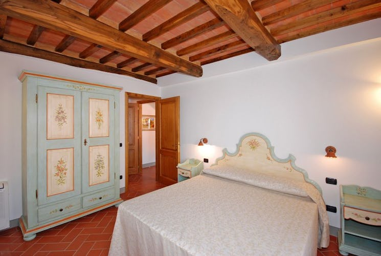 Handpainted furniture and lumiunous bedrooms at Villa Montegufoni