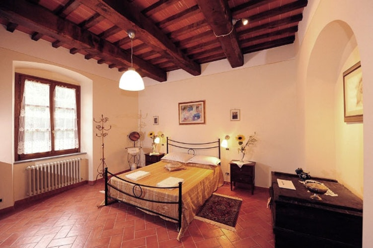 The bedrooms have classic Tuscan accents and WiFi access.